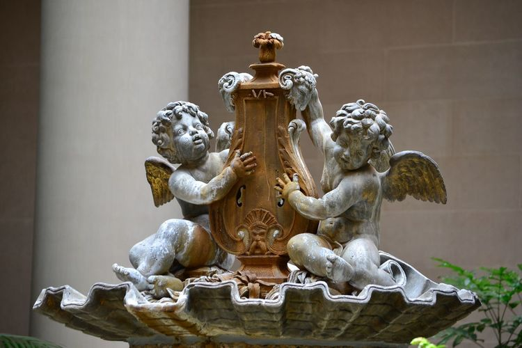 Angel Sculptures On Fountain