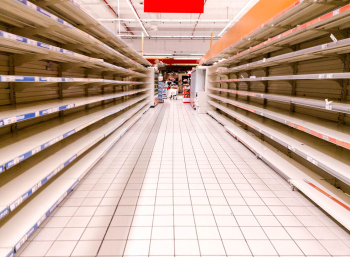 View of empty shelves in supermarket