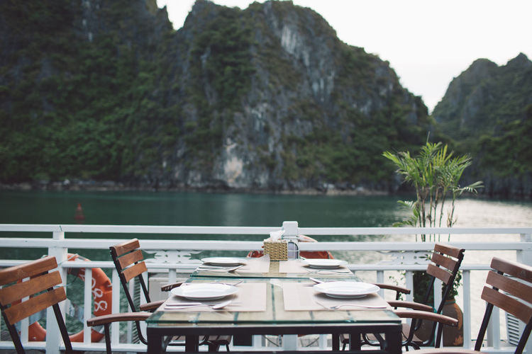 View of restaurant by lake against mountains
