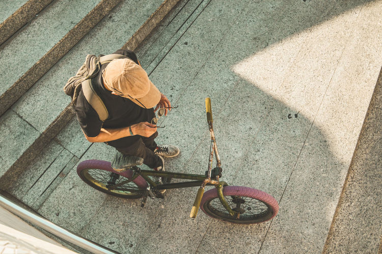 High angle view of man riding bicycle on street