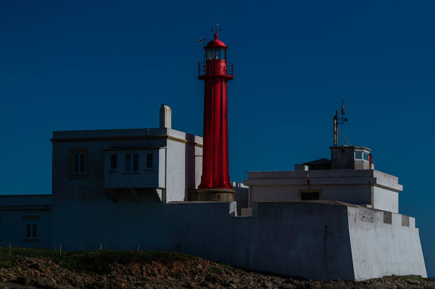 Architecture Blue Building Building Exterior Built Structure Clear Sky Day Direction Guidance Guincho Lighthouse Low Angle View Nature No People Outdoors Red Security Sky Tall - High Tower Travel Destinations