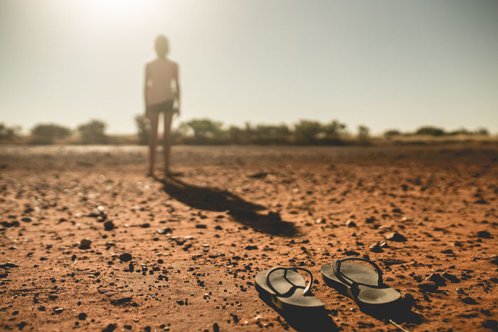 stepping out barefoot Moody Backlight Sunlight Dust Outback Australia Outback Outback Australia No Shoes Lost Anxiety  Despression Anxiety  Girl In Fog Girl Thongs Sand Sky FootPrint Sandal