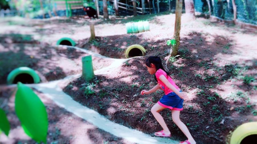 Rabbit village @ kampung apin-apin One Person Real People Lifestyles Leisure Activity Child Full Length Childhood Enjoyment Fun Outdoors Nature