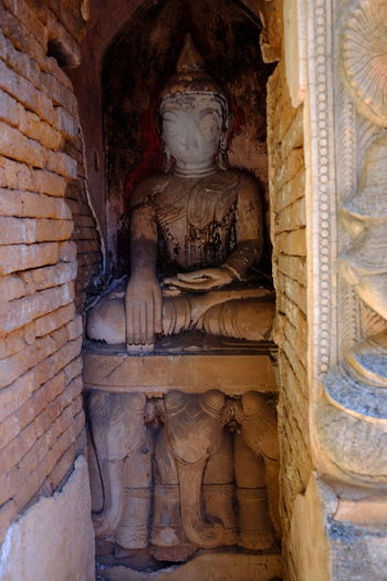 Buddha Inside Ancient stupa (One of 2,527 stupas on this site 11th to 13th century), Kakku Ancient Animal Representation Buddha Statue Buddhism Buddhist Culture Composition Elephants Full Frame History Human Representation Inle Lake Kakku Myanmar No People Old Ruin Outside Photography Place Of Worship Religion Shan State Spirituality Statue Stupa Sunlight And Shadow Tourism Travel Destinations