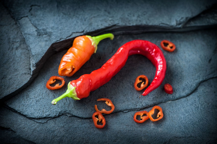 Bell Pepper Chili Pepper Close-up Food Food And Drink Freshness Gray Group Of Objects Healthy Eating Indoors  Ingredient Medium Group Of Objects No People Pepper Pepper - Vegetable Red Red Chili Pepper Snack Spice Vegetable Wellbeing