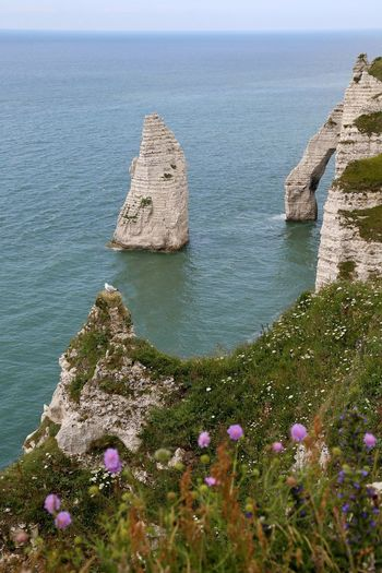 Scenic view of rock formation by sea at etretat
