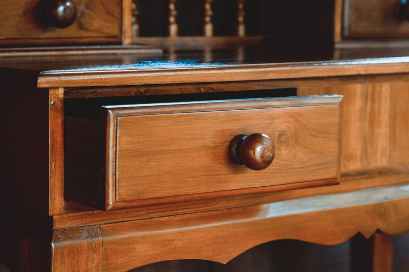 Close-up of wooden drawer at home