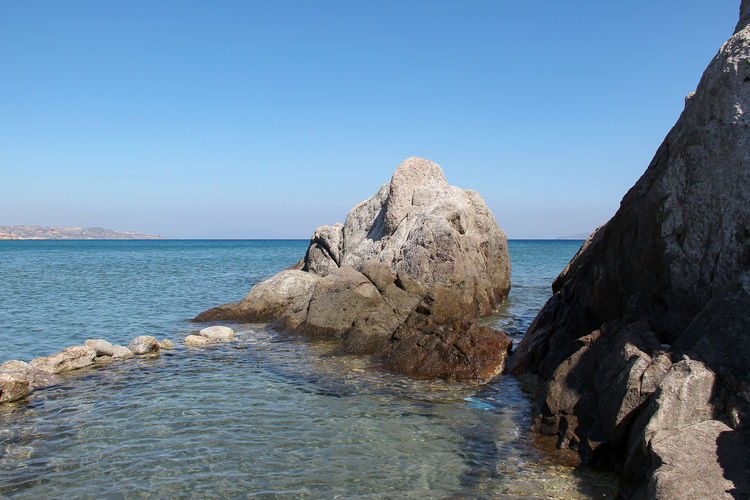 Sea Water Sky Scenics - Nature Rock Beauty In Nature Rock - Object Solid Tranquil Scene Tranquility Clear Sky Rock Formation Nature Copy Space Horizon Over Water Horizon Land Idyllic Blue No People Outdoors Stack Rock Kos Greece