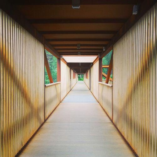 Empty narrow corridor along walls