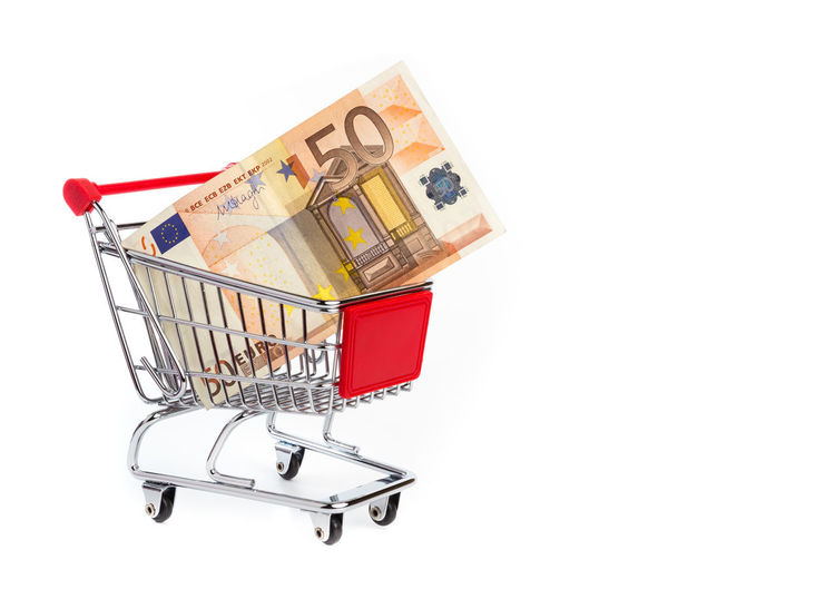 Consuming concept with shopping cart and 50 euro bill inside 50 Business Currency European  Isolated Loan  Market Background Bank Banking Banknote Basket Bill Bills Buy Cart Cash Consumer Euro Exchange Fifty Finance Financial Grocery Investment