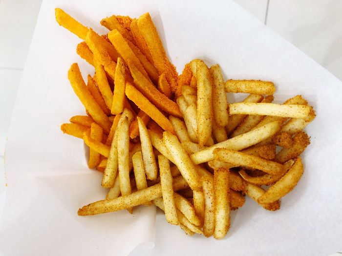 Cheesy and Chilly flavors Ready-to-eat Freshness Food French Fries Food And Drink Prepared Potato Indoors
