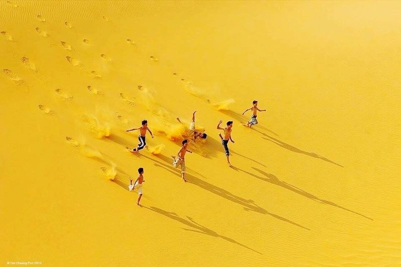 Desert of Algeria - Golden Sands Yellow Only Men Adults Only Speed Studio Shot Yellow Background Men Young Adult Adult Togetherness Competition Sand Young Men People Full Length Outdoors Day Sports Race Men's Track Sportsman EyeEm Best Shots - Nature Nature Algérie Algeria EyeEm