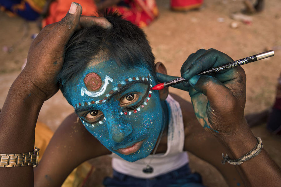 A boys face being painted as the process of transformation into goddess kali. This ritual is part of maha shivaratri festival celebrated in Angala Amman temple at Kaveripattinam. Boy Close-up Creativity Devine Eyes Face Facepainting Festival Goddess Human Representation Kali Kaveripattinam Looking At Camera Makeover Makeup Painting Portrait ShivaRatri Showcase March Staring Tradition Blue Wave The Portraitist - 2016 EyeEm Awards