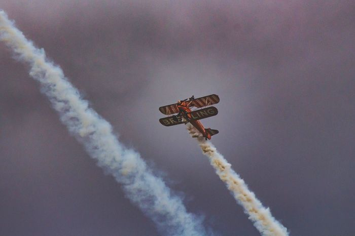 Airplane Smoke - Physical Structure Low Angle View Flying Vapor Trail Speed Airshow Sky Air Vehicle Mid-air Transportation Day No People Outdoors Aerobatics RISK Stunt Military Airplane Fighter Plane Lookingup Aeroplane Airshow Breitling Low Angle View