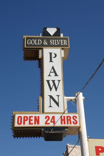 Clear Sky Day Gold & Silver Pawn Shop Harrison Las Vegas Lasvegas No People Outdoors Pawnshop Road Sign Text