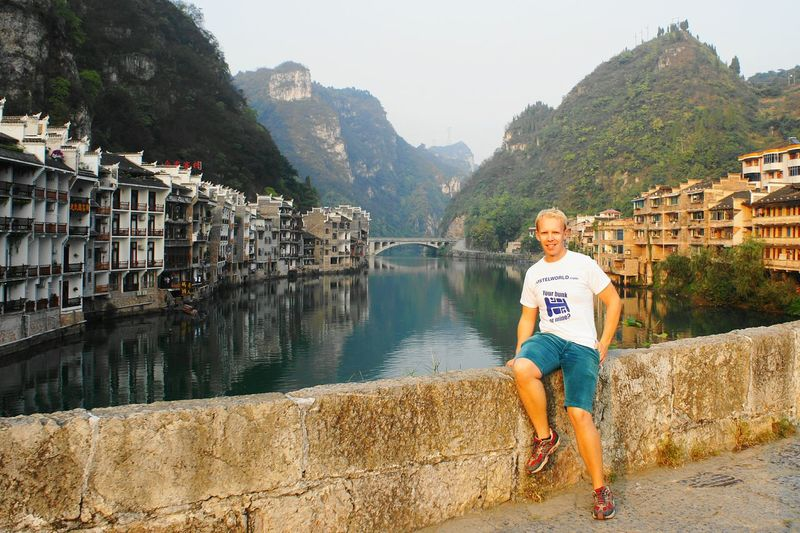 Me in Zhenyuan China. This is one of the most picturesque places i visited in the country. China Traveling In China Zhenyuan Guizhou Guizhou,china Chinese Culture Badfashion Bad Fashion Hostelworld Tshirt Arcitecture River River View Wanderlust Travel Photography Mountains Nature Photography Ilovetravel Mountain View Picturesque Old Houses