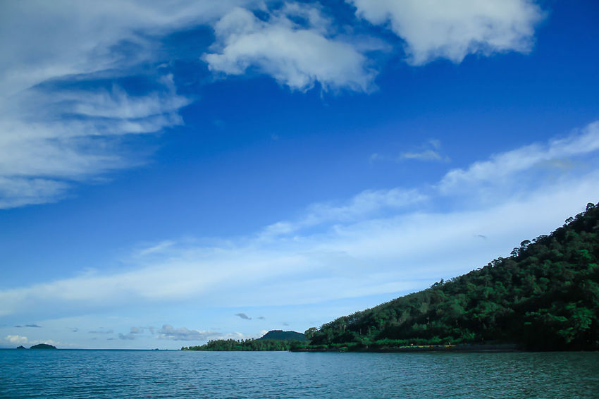 Sea View Clouds in the Sky on a Bright Day Beauty In Nature Blue Cloud - Sky Day Idyllic Landscape Sea Landscape Seascape Mountain Nature No People Non-urban Scene Outdoors Plant Scenics - Nature Sea Sky Tranquil Scene Tranquility Tree Water Waterfront