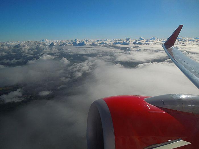 Over the clouds Air Travel  Airplane Cloud Clouds And Sky Distance Flugreise Flugzeug Over The Clouds Recreational Pursuit Red Airplane Wolkenhimmel über Den Wolken Muss Die Freiheit Wohl Grenzenlos Sein