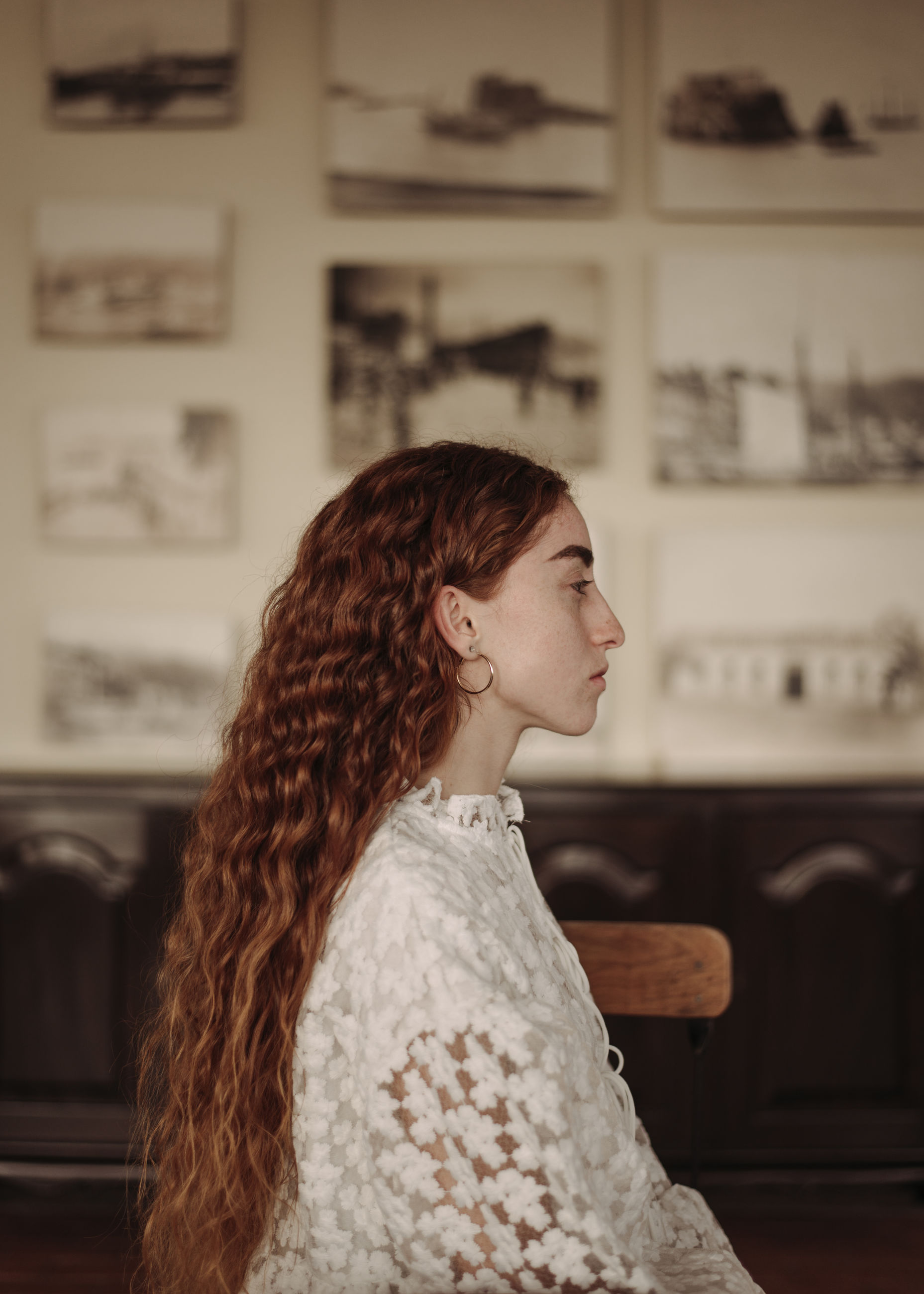 one person, hairstyle, young adult, women, real people, young women, casual clothing, standing, focus on foreground, lifestyles, indoors, hair, looking, waist up, looking away, leisure activity, side view, long hair, beautiful woman, contemplation, warm clothing, teenager