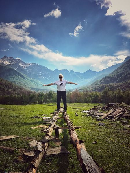 Real People One Person Standing Mountain Full Length Leisure Activity Beauty In Nature Casual Clothing Scenics Day Nature Arms Outstretched Outdoors Cloud - Sky Sky Lifestyles Grass Mountain Range Hiking Landscape Albania