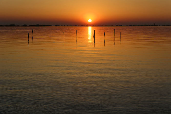 Jus A Moment Beauty In Nature Horizon Idyllic Nature No People Non-urban Scene Orange Color Outdoors Reflection Remote Scenics - Nature Sea Sky Sun Sunset Tranquil Scene Tranquility Water Waterfront