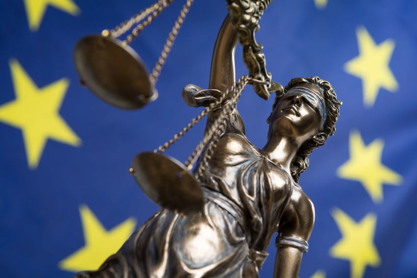 Statue of the blindfolded goddess of justice Themis or Justitia, against an European flag, as a legal concept Authority Court Decisions Democracy European Union Lady Justice Politics Rules Statue Concept Courthouse Eu Europe Flag Gavel Goddess Judge Judgement Justice Law Legal Legislation Order Sculpture Symbol
