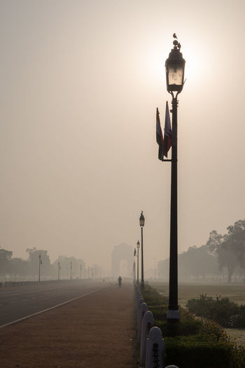 sun behind street lamp in rajpath, Delhi. India Delhi India Gate India Travel Indiapictures Pole Rajpath Streetlamp Sunandsky Sunlight