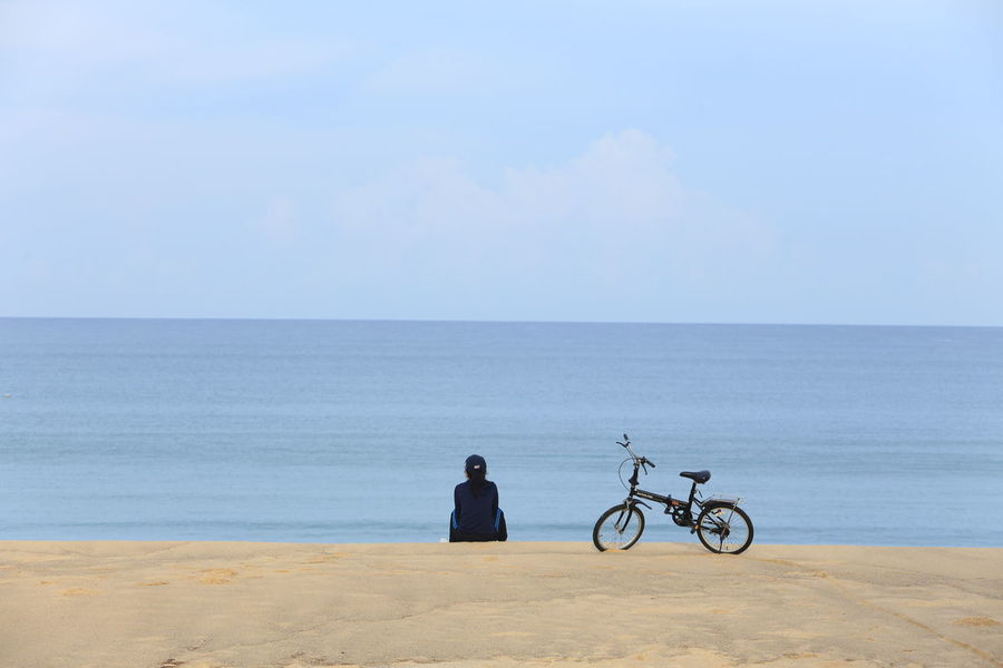 Adult Beach Beauty In Nature Bicycle Clear Sky Cycling Day Full Length Horizon Over Water Horizontal Outdoors Pedal People Person Sand Sea Sky Tranquility Two People