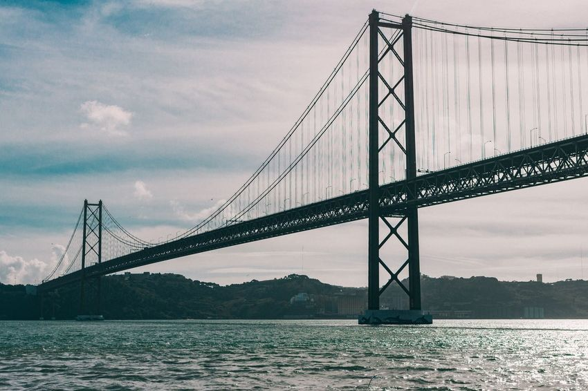 Cross over to the other side Connection Bridge - Man Made Structure Water Suspension Bridge Sky Engineering Architecture Built Structure Transportation Travel Travel Destinations Sea Outdoors Bridge Cloud - Sky No People Nature Day Lisbon Lisboa EyeEm Best Shots
