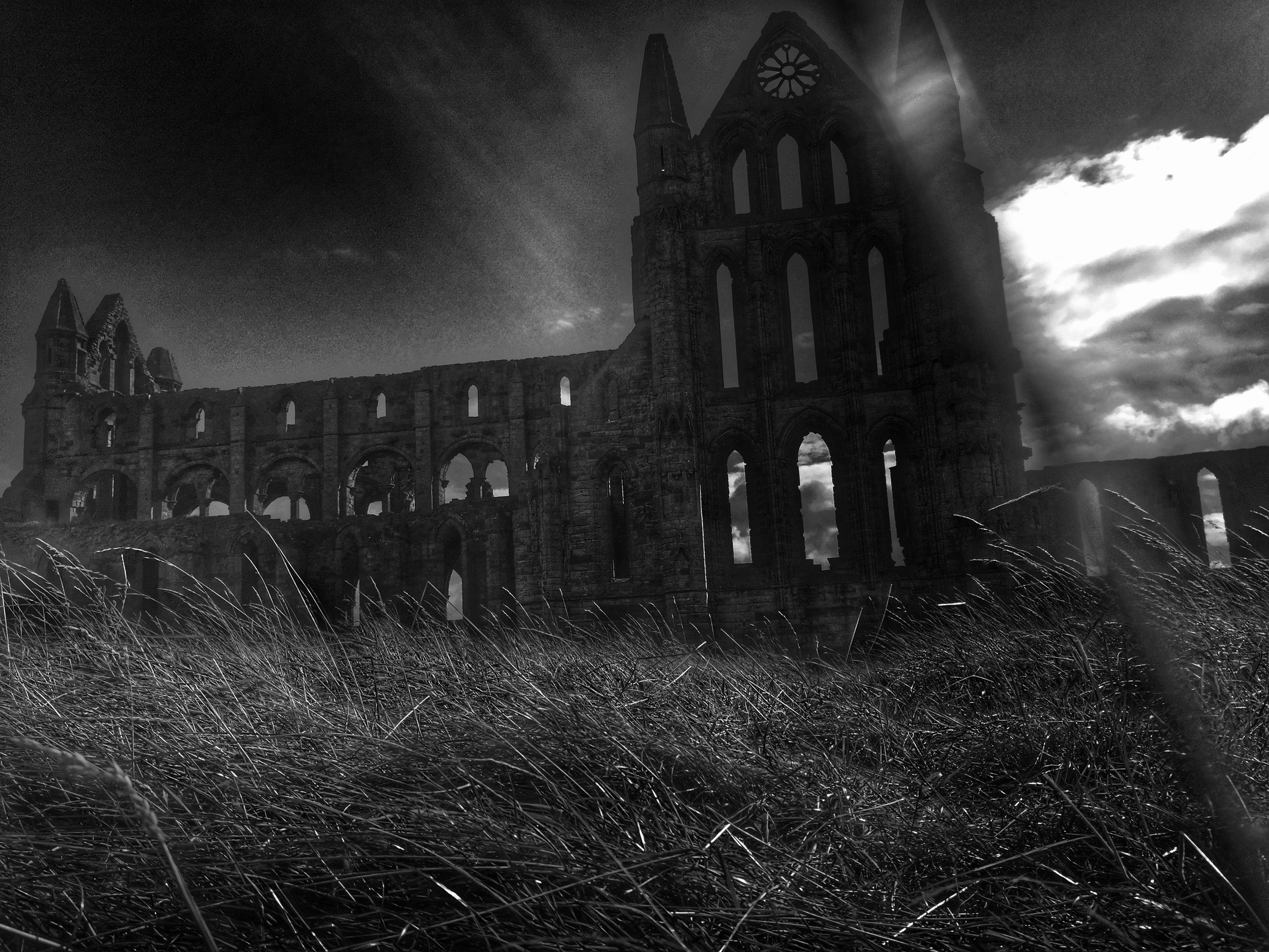architecture, built structure, building exterior, religion, church, place of worship, sky, facade, outdoors, lawn, dark, history, no people, chapel, exterior, local landmark