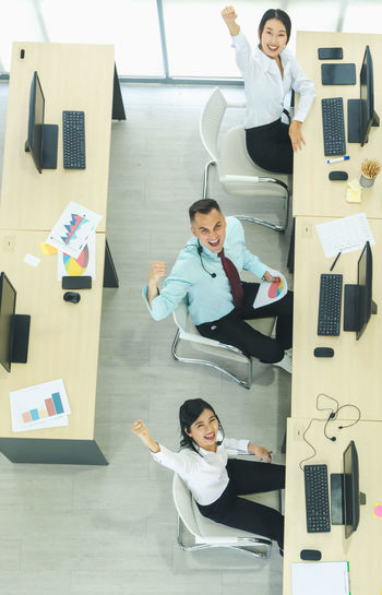 High angle view of business people sitting at office