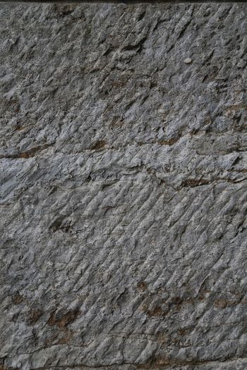 Backgrounds Full Frame Gray Textured  No People Close-up Day Solid Architecture Wall - Building Feature Outdoors Rock - Object Nature Rock Extreme Close-up Pattern Stone Material Built Structure Rough Copy Space Textured Effect