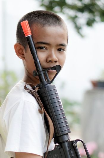 One Person Portrait Holding Playing Kid With A Gun Army Headshot Looking At Camera Weapon One Boy Only