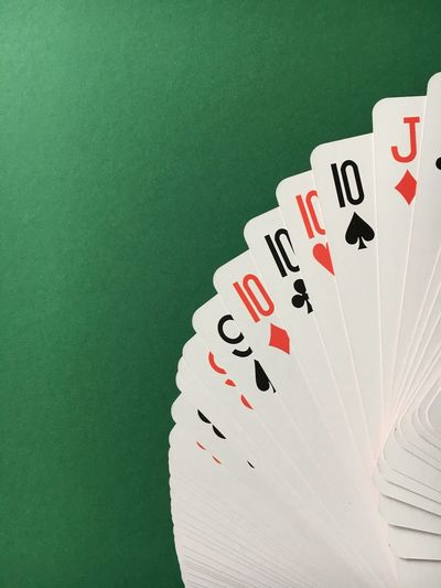 Gambling Cards Luck Leisure Games Studio Shot Close-up Green Background No People Chance Poker Night Pokerface Poker Time PokerGame Poker Poker - Card Game Texas Hold'em Green Card Cards On The Table Table