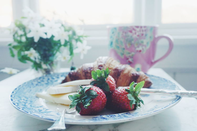 Breakfast with tea, croissant, cheese and strawberries Breakfast Close-up Day Flower Flowers Focus On Foreground Food Food And Drink Freshness Fruit Healthy Eating Indoors  No People Plate Ready-to-eat Spring Flowers Table Tea Wood Anemone