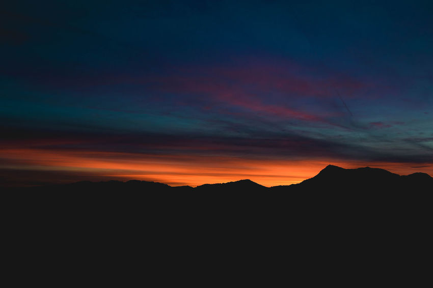 burning sky Beauty In Nature Beauty In Nature Canon Landscape Mountain Mountain Range Nature No People Outdoors Scenics Silhouette Sky Sunset Switzerland Tranquil Scene Tranquility
