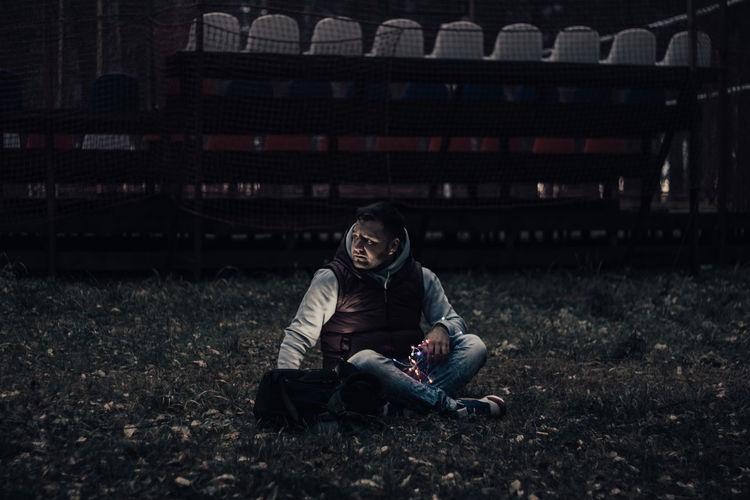 Full length of man sitting on land