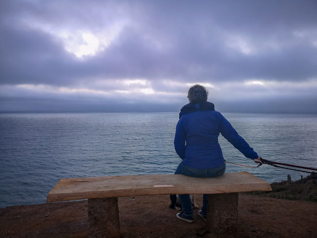 just enjoying the last light Sat On A New Bench Cornish Coast Before Dark Nature Popular Photos Copy Space Looking Out To Sea Autumn Nights Water Sea Women Full Length Beach Sky Horizon Over Water Human Back Calm Dramatic Sky Back