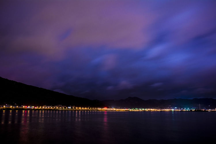 Scenic View Of Lake Against Cloudy Sky At Night