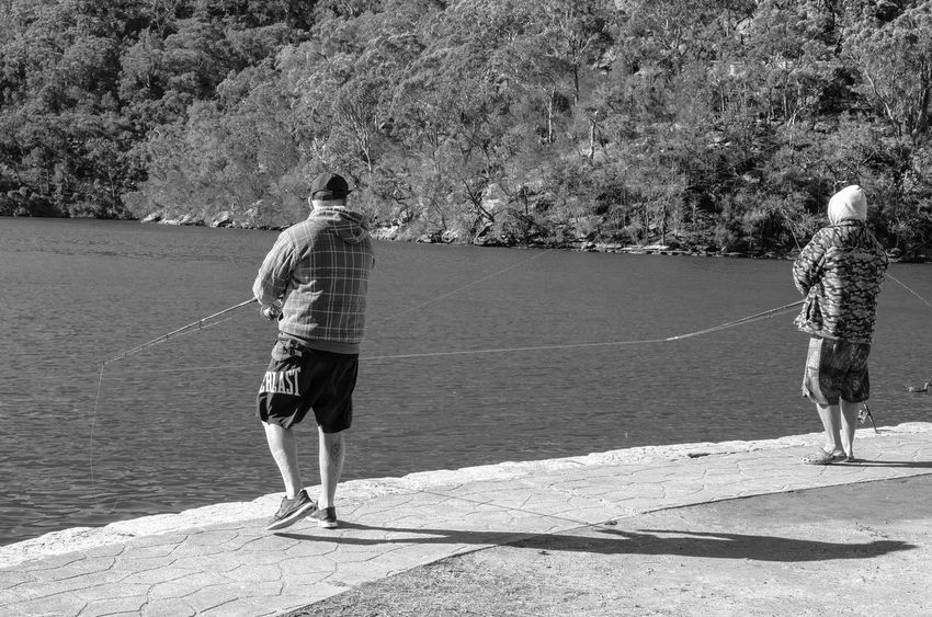 Fishing Monochrome Light And Shadow Black And White Real People Full Length Sunlight Rear View Day Nature Lifestyles Water People Leisure Activity Shadow Walking Standing Outdoors