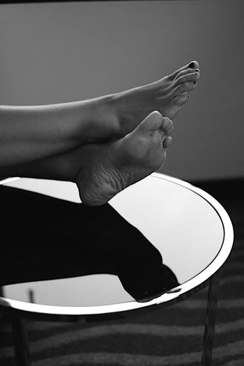 Foot on the table Eye4black&white  Eye4photography  Eyem Gallery EyeEm Best Shots monochrome photography Monochrome Blackandwhite Bnw_collection Bnw Beauty Inspired Creativity Creative Artistic Visual Glasstable Table Reflection Elégance Feet Womansfoot Footonthetable Foot Human Body Part Real People Holding Human Leg Indoors  Close-up