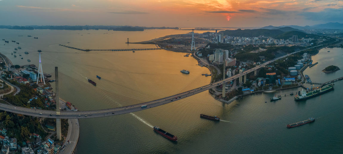 Bai chay Bridge Ha Long Bay Sea Sea And Sky Sky Sunset Boat Bridge Architecture Water Built Structure City Cloud - Sky High Angle View Mode Of Transportation Travel Aerial View Cityscape Bridge - Man Made Structure Travel Destinations Transportation
