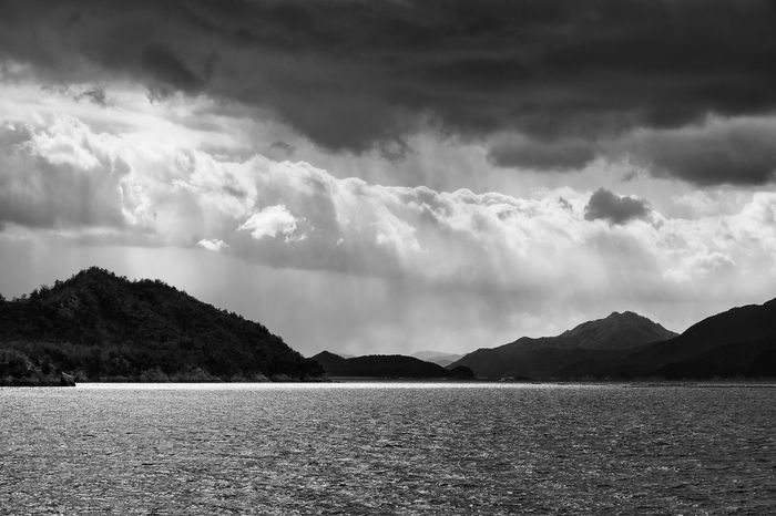 View from Ninoshima, a small island in Hiroshima Bay Hiroshima Japan Sea Sky Cloud Cloudscape Landscape Storm Storm Cloud Moody Water Island Ocean Monochrome Black And White Blackandwhite No People Nature Outdoors Mountain Beauty In Nature Silhouette Horizon Over Water Sun Rays