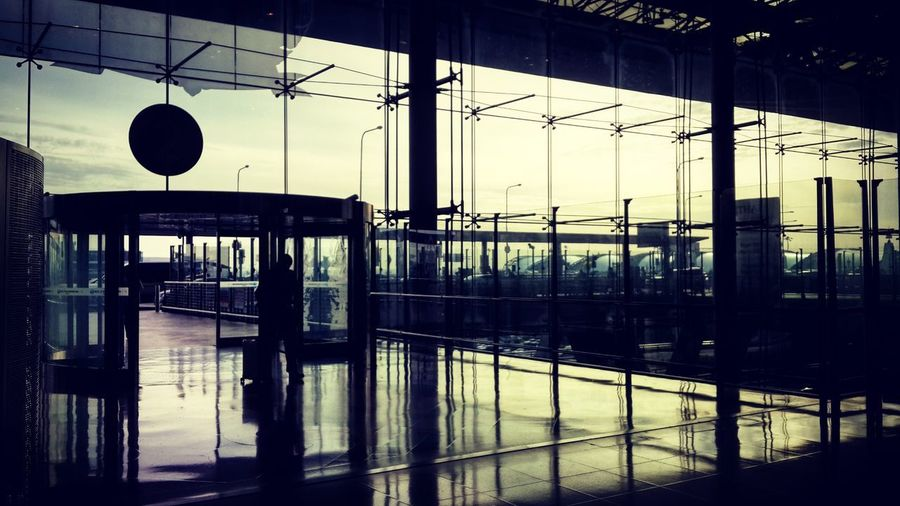 Airport Departure Area Architecture Built Structure Transportation Transparent Indoors  Reflection Day Mode Of Transportation Glass - Material No People Window Rail Transportation Nature Travel Silhouette Railing Railroad Station Public Transportation Glass Airport Airportphotography Airport Departure Area Airport Terminal Morning Redeyeflights