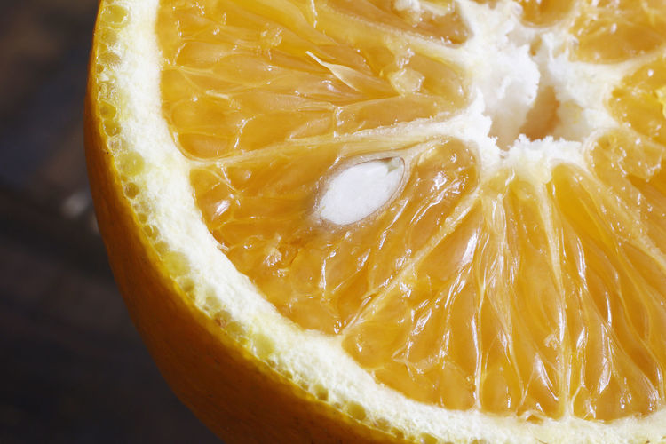 Food And Drink Food Healthy Eating Citrus Fruit SLICE Fruit Close-up Freshness No People Wellbeing Orange Color Indoors  Cross Section Still Life Single Object Orange - Fruit Orange Studio Shot Focus On Foreground Halved Ripe Vitamin C