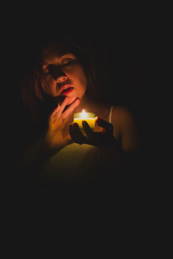 Black Background Candle Candlelight Dark Eyes Closed  Face Flame Headshot Mysterious Night Portrait Shadows Woman