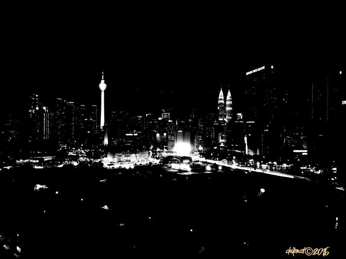 Night Cityscape Built Structure City Urban Skyline Modern Skyscraper City Life Dark Glowing Tall - High Distant Architecture Bnw_friday_challenge Bnw_magazine Bnw_worldwide Bnw_society Bnw_captures Bnw_planet Bnw_city Fresh On Eyeem  Bnw Photography Klpf2016