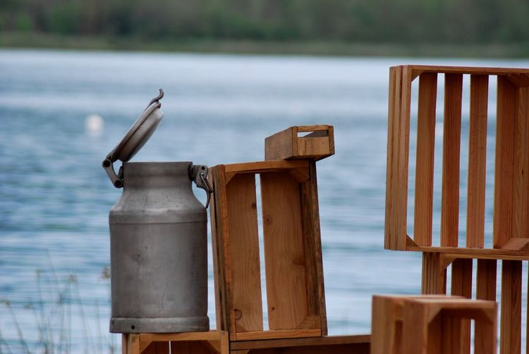 Canister on wooden crates at lakeshore