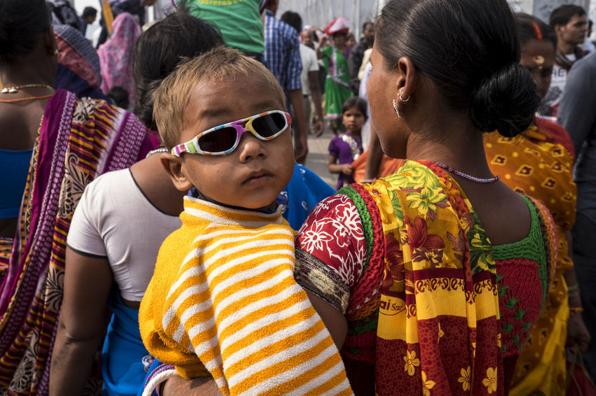 Mum carrying her young child who is wearing multi-coloured sunglasses Bihar Celebration Child Cool Cute Fun Funky Hajipur India Multi Colored Mum Mum And Child Sonepur Sonepurmela Sun Sunglasses Travel Travel Photography
