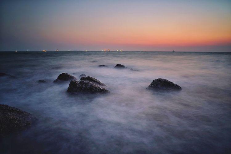 smooth sea Galaxy Water Sea Cityscape Sunset Wave Beach Horizon Urban Skyline Blue Romantic Sky